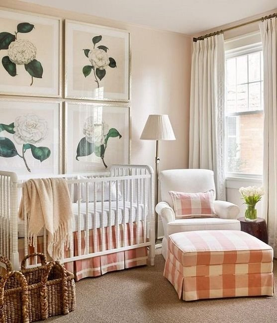 a cozy farmhouse nursery with peach and white plaid textiles and flower artworks may be nice for a girl