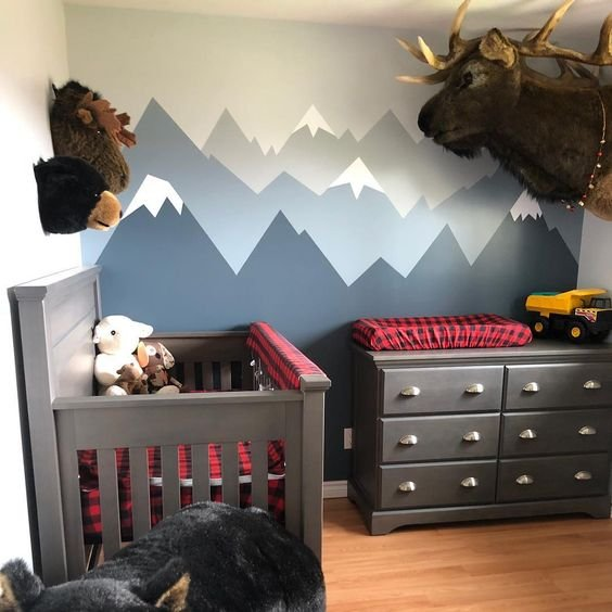 a woodland inspired nursery with red and navy plaid textiles that add print and color to the space