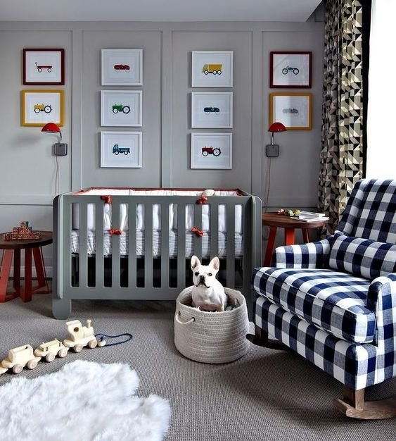a plaid rocker chair and geometric print curtains add interest and coziness to the light grey nursery