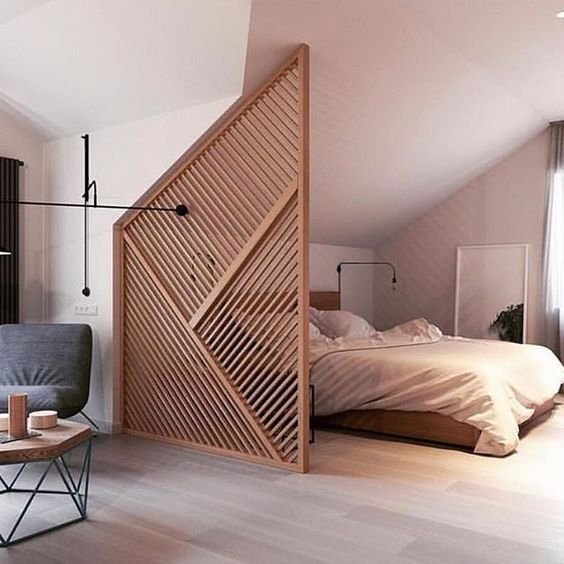 a stylish attic wooden screen with a geometric pattern will subtly divide the spaces