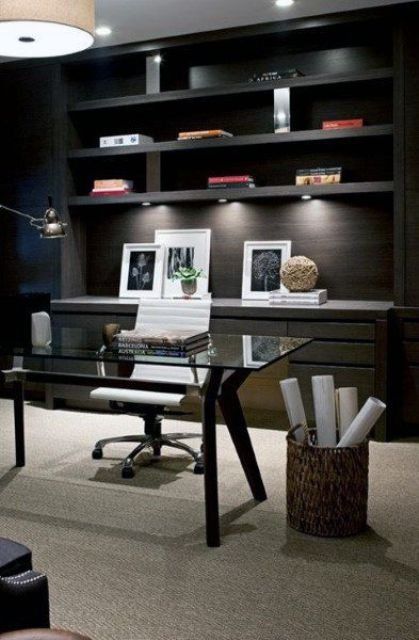 a black home office refreshed with a light-colored floor and built-in lights plus a white chair