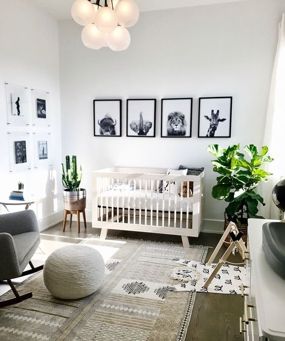 a stylish black and white gallery wall with animals is a super stylish idea that fits a gender-neutral space