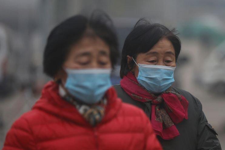 Chinese women wear masks on Sunday.