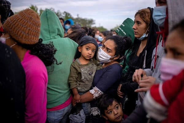 A group of migrants waiting in La Joya, Texas, to board a bus from Customs and Border Protection after crossing the Rio Grande in March. Last month, border agents encountered nearly 19,000 children at the border.Credit...Adrees Latif/Reuters