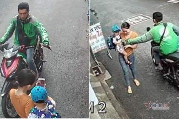 Tài xế GrabBike giật điện thoại người phụ nữ bế con trên đường Sài Gòn