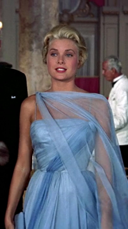 a blond woman in a fancy blue gown