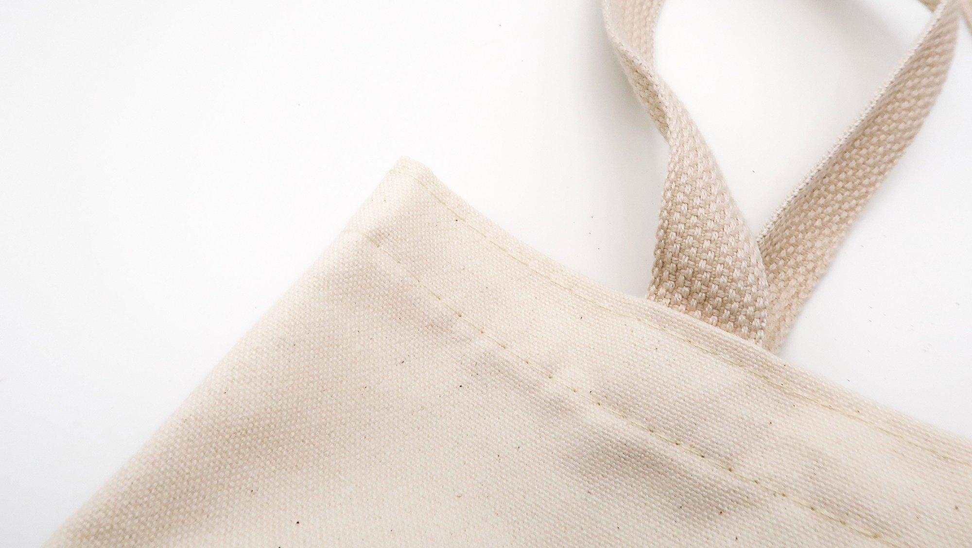 a plain off white cotton tote