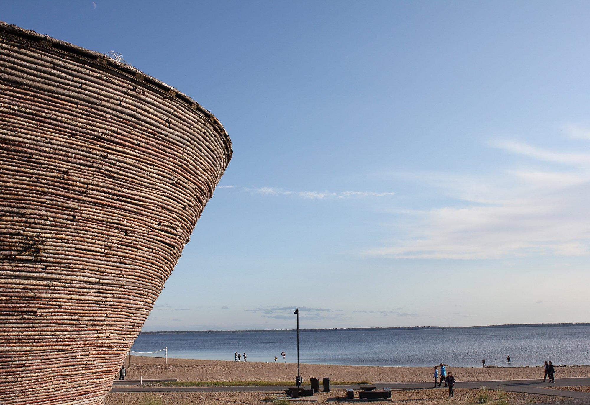 a unique building alonside a vast shoreline