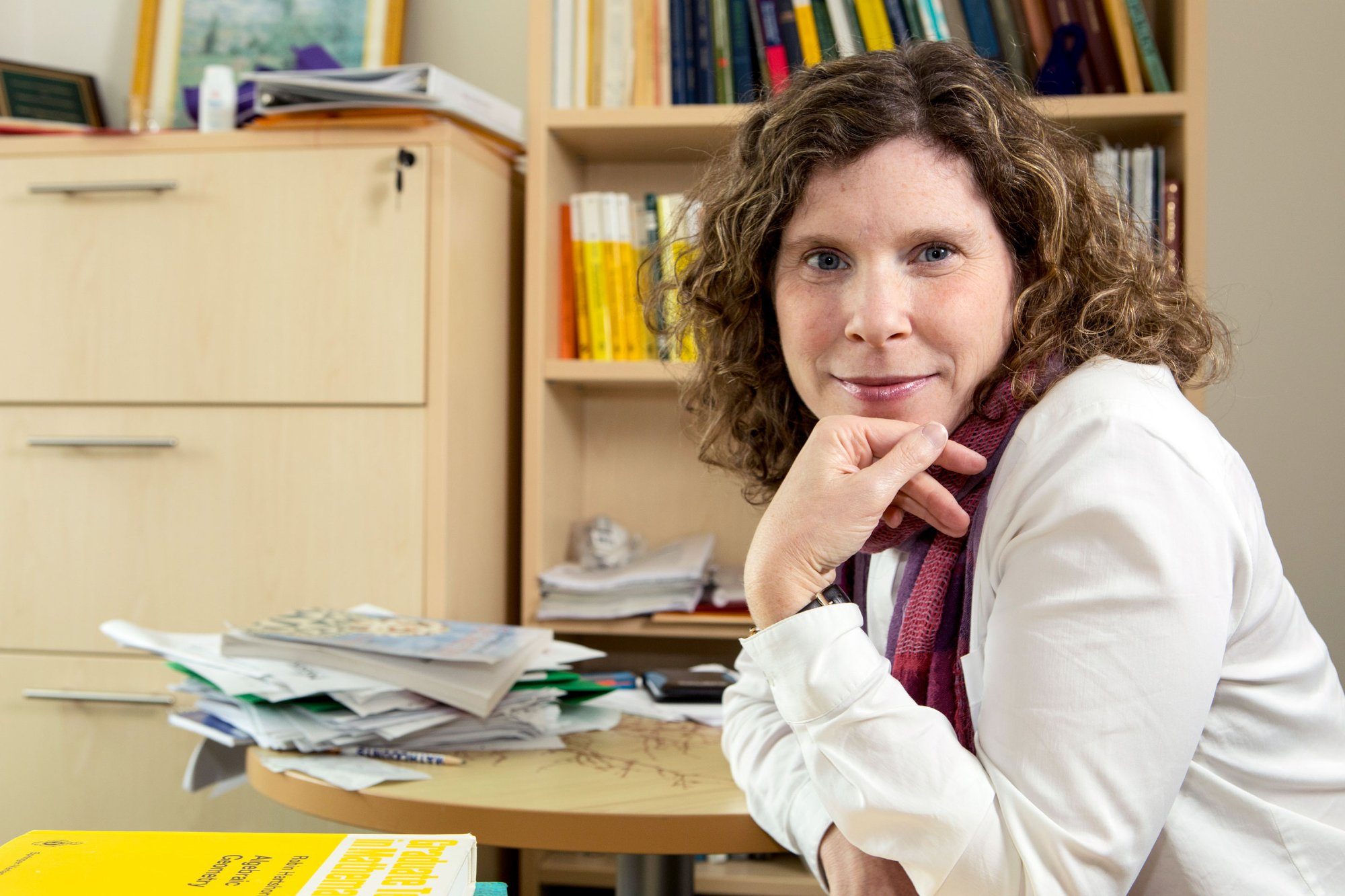 a woman posing for a portrait from an office