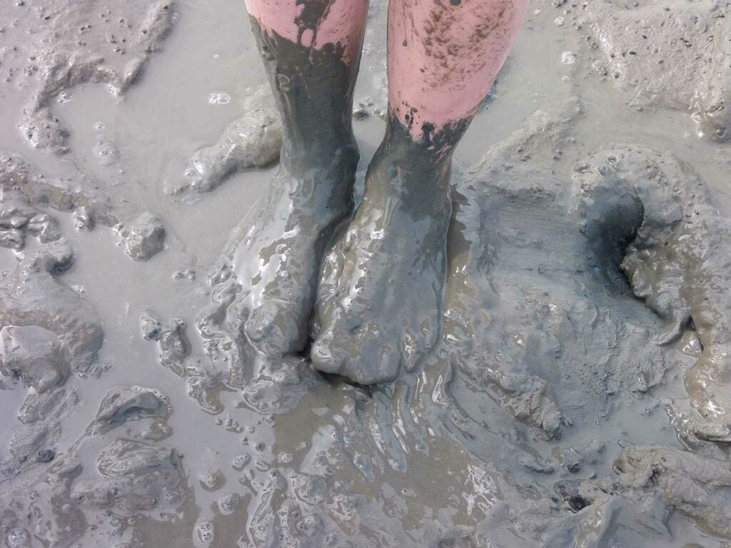 feet covered in mud